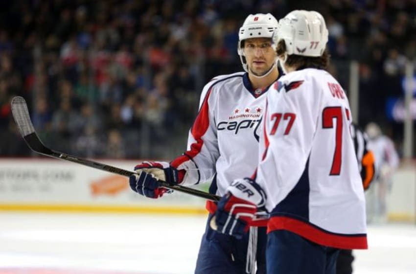 Feb 18, 2016; Brooklyn, NY, USA; Washington Capitals left wing Alex Ovechkin (8) talks to Washington Capitals right wing T.J. Oshie (77) during the first period against the New York Islanders at Barclays Center. Mandatory Credit: Brad Penner-USA TODAY Sports