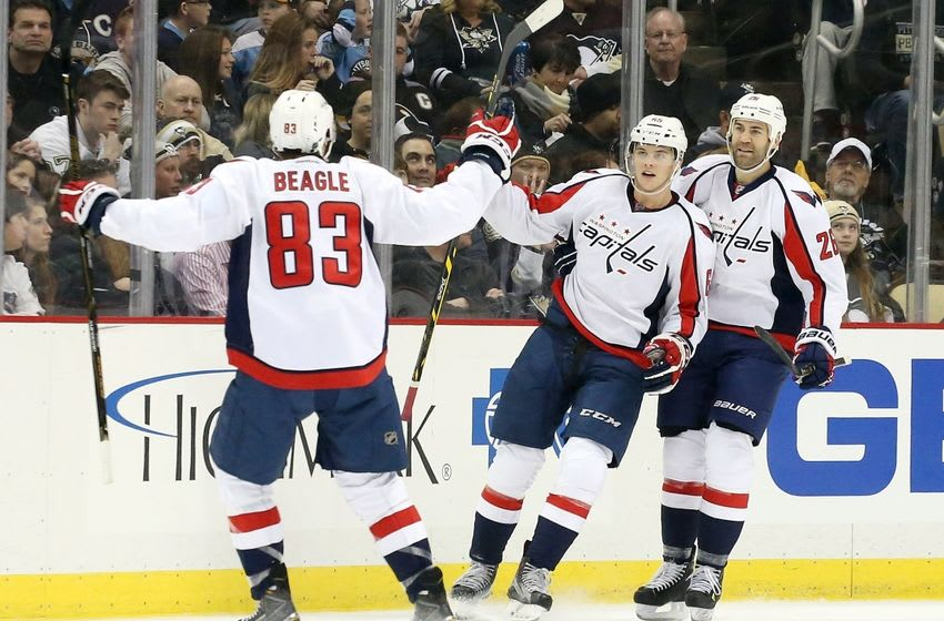 Mar 20, 2016; Pittsburgh, PA, USA; Washington Capitals center Jay Beagle (83) and left wing Andre Burakovsky (middle) and right wing Daniel Winnik (26) celebrate a goal by Burakovsky against the Pittsburgh Penguins during the second period at the CONSOL Energy Center. The Penguins won 6-2. Mandatory Credit: Charles LeClaire-USA TODAY Sports