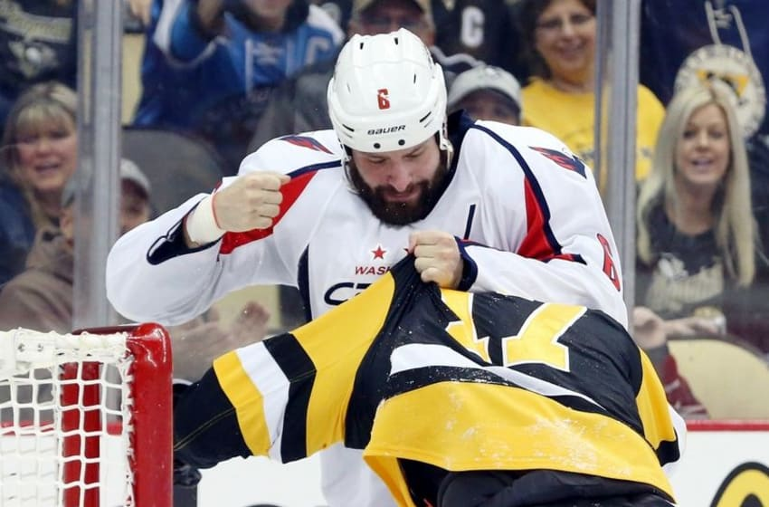 Mar 20, 2016; Pittsburgh, PA, USA; Washington Capitals defenseman Mike Weber (6) fights with Pittsburgh Penguins right wing Bryan Rust (17) during the second period at the CONSOL Energy Center. Mandatory Credit: Charles LeClaire-USA TODAY Sports
