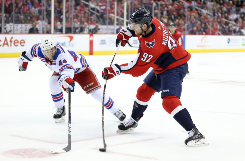 WASHINGTON, DC - OCTOBER 17: Evgeny Kuznetsov #92 of the Washington Capitals shoots the puck past Neal Pionk #44 of the New York Rangers during the third period at Capital One Arena on October 17, 2018 in Washington, DC. (Photo by Will Newton/Getty Images)