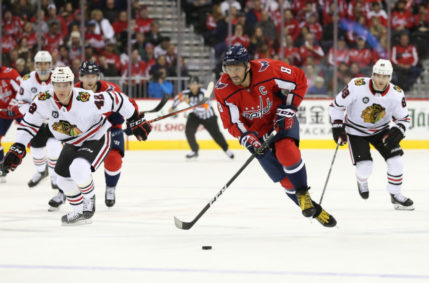 WASHINGTON, DC - NOVEMBER 21: Alex Ovechkin #8 of the Washington Capitals skates with the puck in front of Gustav Forsling #42 of the Chicago Blackhawks during the second period at Capital One Arena on November 21, 2018 in Washington, DC. (Photo by Will Newton/Getty Images)