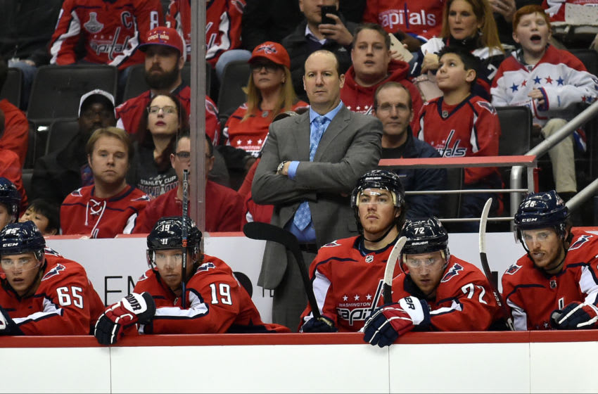 WASHINGTON, DC - FEBRUARY 26: Washington Capitals head coach Todd Reirden watches from the bench behind Andre Burakovsky (65), Nicklas Backstrom (19), T.J. Oshie (77), Travis Boyd (72), and Nic Dowd (26) during the Ottawa Senators vs. Washington Capitals NHL game February 26, 2019 at Capital One Arena in Washington, D.C.. (Photo by Randy Litzinger/Icon Sportswire via Getty Images)