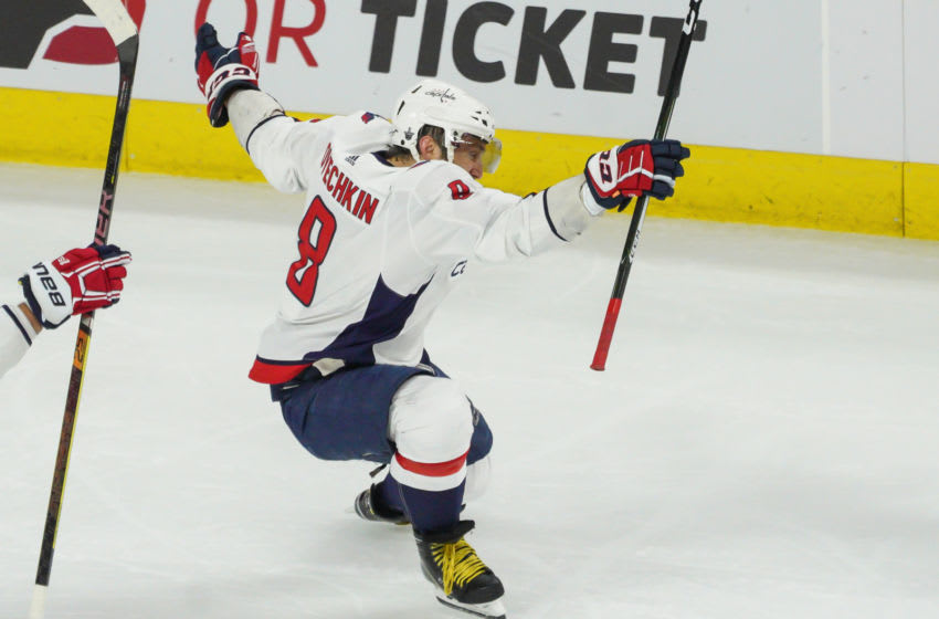 RALEIGH, NC - APRIL 22: Washington Capitals left wing Alex Ovechkin (8) celebrates after scoring in the first period during a game between the Carolina Hurricanes and the Washington Capitals on April 22, 2019 at the PNC Arena in Raleigh, NC. (Photo by Greg Thompson/Icon Sportswire via Getty Images)