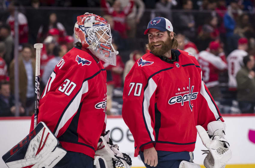 WASHINGTON, DC - OCTOBER 16: Ilya Samsonov #30 of the Washington Capitals celebrates with Braden Holtby #70 after the game against the Toronto Maple Leafs during the third period at Capital One Arena on October 16, 2019 in Washington, DC. (Photo by Scott Taetsch/Getty Images)