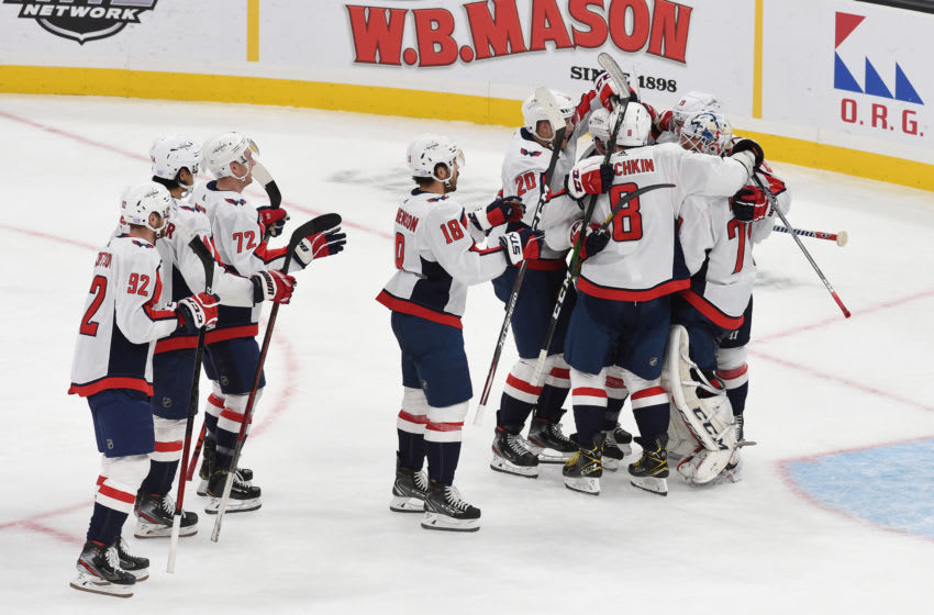 BOSTON, MA - NOVEMBER 16: The Washington Capitals celebrate the shootout win against the Boston Bruins at the TD Garden on November 16, 2019 in Boston, Massachusetts. (Photo by Steve Babineau/NHLI via Getty Images)