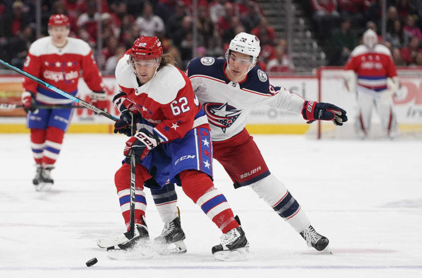 WASHINGTON, DC - DECEMBER 09: Carl Hagelin #62 of the Washington Capitals skates with the puck against Sonny Milano #22 of the Columbus Blue Jackets in the first period at Capital One Arena on December 9, 2019 in Washington, DC. (Photo by Patrick McDermott/NHLI via Getty Images)
