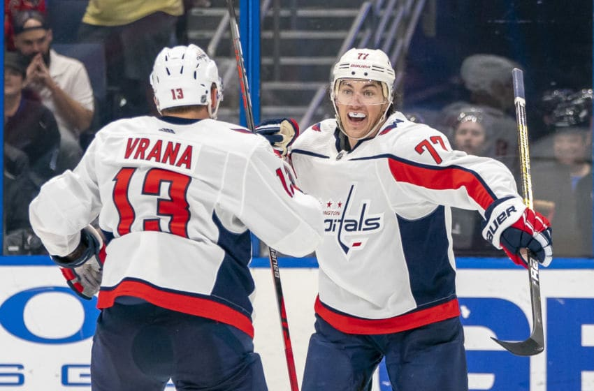 TAMPA, FL - DECEMBER 14: Washington Capitals right wing T.J. Oshie (77) celebrates his wrap around goal with Washington Capitals left wing Jakub Vrana (13) during the NHL Hockey match between the Lightning and Capitals on December 14, 2019 at Amalie Arena in Tampa, FL. (Photo by Andrew Bershaw/Icon Sportswire via Getty Images)