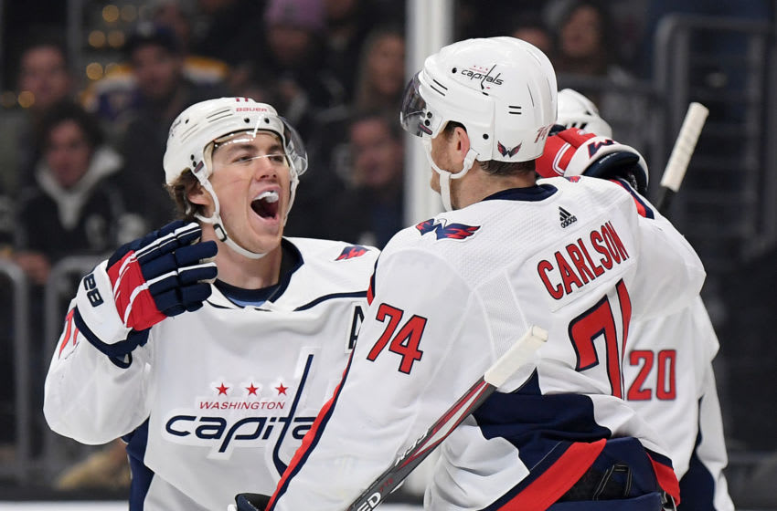 LOS ANGELES, CALIFORNIA - DECEMBER 04: John Carlson #74 of the Washington Capitals celebrates his goal with T.J. Oshie #77, to take a 2-0 lead over the Los Angeles Kings, during the first period at Staples Center on December 04, 2019 in Los Angeles, California. (Photo by Harry How/Getty Images)