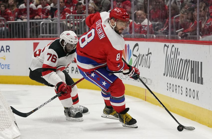 WASHINGTON, DC - JANUARY 11: Alex Ovechkin #8 of the Washington Capitals skates with the puck against P.K. Subban #76 of the New Jersey Devils in the first period at Capital One Arena on January 11, 2020 in Washington, DC. (Photo by Patrick McDermott/NHLI via Getty Images)
