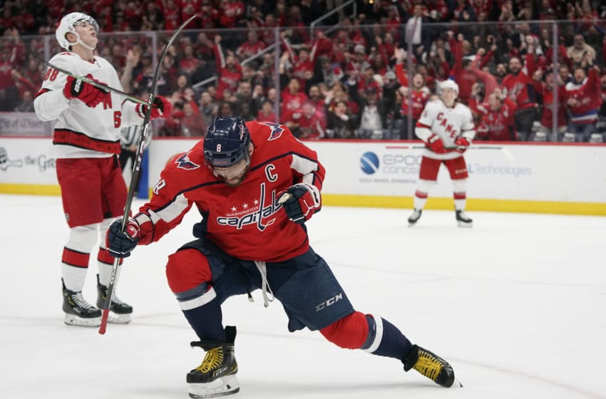 WASHINGTON, DC - JANUARY 13: Alex Ovechkin #8 of the Washington Capitals celebrates after scoring his first goal of the game in the first period against the Carolina Hurricanes at Capital One Arena on January 13, 2020 in Washington, DC. (Photo by Patrick McDermott/NHLI via Getty Images)