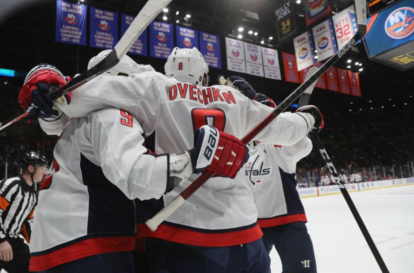 UNIONDALE, NEW YORK - JANUARY 18: Jakub Vrana #13 of the Washington Capitals celebrates his game winning goal at 17:30 of the third period against the New York Islanders and is joined by Alex Ovechkin #8 at NYCB Live's Nassau Coliseum on January 18, 2020 in Uniondale, New York. The Capitals defeated the Islanders 6-4. (Photo by Bruce Bennett/Getty Images)