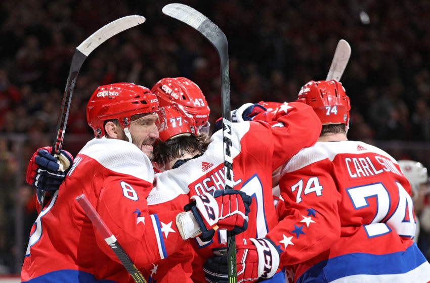 WASHINGTON, DC - FEBRUARY 10: Alex Ovechkin #8 of the Washington Capitals celebrates a goal by teammate T.J. Oshie #77 of the Washington Capitals against the New York Islanders during the second period at Capital One Arena on February 10, 2020 in Washington, DC. (Photo by Patrick Smith/Getty Images)