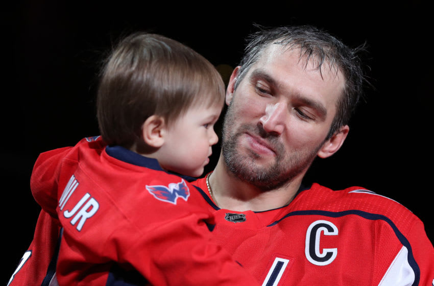 WASHINGTON, DC - FEBRUARY 25: Alex Ovechkin #8 of the Washington Capitals holds his son, Sergei Ovechkin, as he acknowledges the crowd as he is honored for scoring 700 career NHL goals prior to playing against the Winnipeg Jets at Capital One Arena on February 25, 2020 in Washington, DC. (Photo by Patrick Smith/Getty Images)