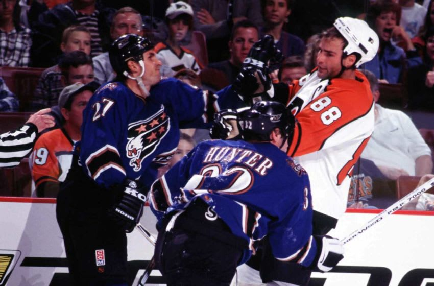 2000 Season: Craig Berube and Dale Hunter battle Eric Lindros along the boards. (Photo by Bruce Bennett Studios via Getty Images Studios/Getty Images)
