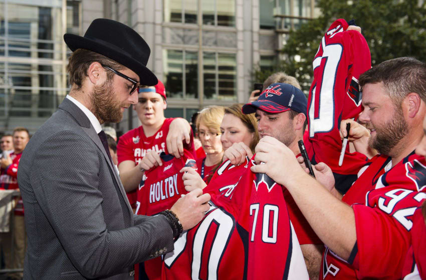 WASHINGTON, DC - OCTOBER 07: Braden Holtby #70 of the Washington Capitals signs autographs for fans on the Rock the Red Carpet prior to the start of a game against the Montreal Canadiens at Capital One Arena on October 7, 2017 in Washington, DC. (Photo by Patrick McDermott/NHLI via Getty Images)