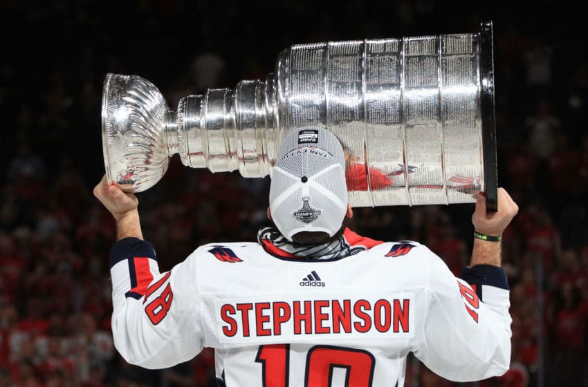 LAS VEGAS, NV - JUNE 07: Chandler Stephenson #18 of the Washington Capitals hoists the Stanley Cup after Game Five of the 2018 NHL Stanley Cup Final between the Washington Capitals and the Vegas Golden Knights at T-Mobile Arena on June 7, 2018 in Las Vegas, Nevada. The Capitals defeated the Golden Knights 4-3 to win the Stanley Cup Final Series 4-1. (Photo by Dave Sandford/NHLI via Getty Images)