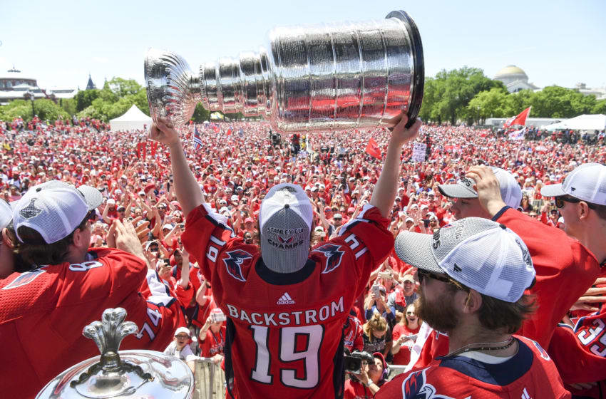 WASHINGTON, DC - JUNE 12: Washington Capitals center Nicklas Backstrom (19) hoists the cup during the Parade for the Stanley Cup Champion Washington Capitals. (Photo by Jonathan Newton/The Washington Post via Getty Images)