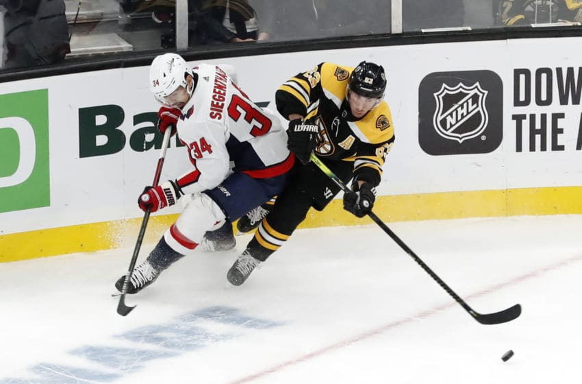 BOSTON, MA - NOVEMBER 16: Boston Bruins left wing Brad Marchand (63) gets past Washington Capitals defenseman Jonas Siegenthaler (34) during a game between the Boston Bruins and the Washington Capitals on November 16, 2019, at TD Garden in Boston, Massachusetts. (Photo by Fred Kfoury III/Icon Sportswire via Getty Images)