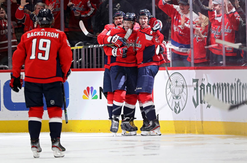 WASHINGTON, DC - DECEMBER 11: John Carlson #74 of the Washington Capitals celebrates his goal with teammates against the Boston Bruins during the third period at Capital One Arena on December 11, 2019 in Washington, DC. (Photo by Patrick Smith/Getty Images)