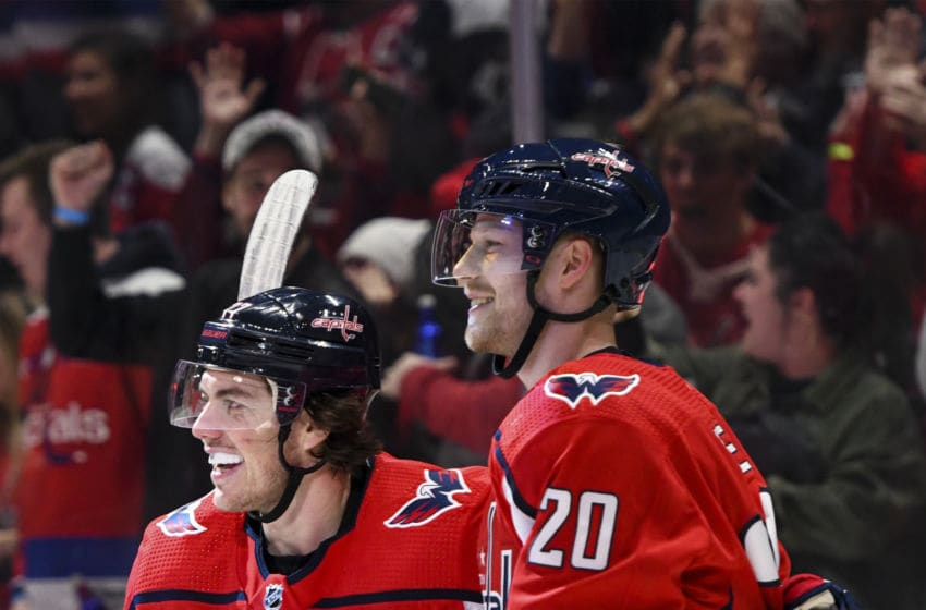 WASHINGTON, DC - JANUARY 05: Washington Capitals center Lars Eller (20) is congratulated by right wing T.J. Oshie (77) after scoring the game winning goal in overtime against the San Jose Sharks on January 5, 2020 at the Capital One Arena in Washington, D.C. (Photo by Mark Goldman/Icon Sportswire via Getty Images)