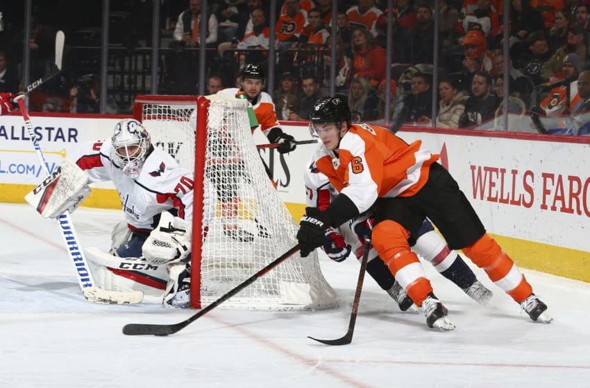 PHILADELPHIA, PA - JANUARY 08: Travis Sanheim #6 of the Philadelphia Flyers controls the puck against Braden Holtby #70 of the Washington Capitals in the third period at the Wells Fargo Center on January 8, 2020 in Philadelphia, Pennsylvania. The Flyers defeated the Capitals 3-2. (Photo by Mitchell Leff/Getty Images)