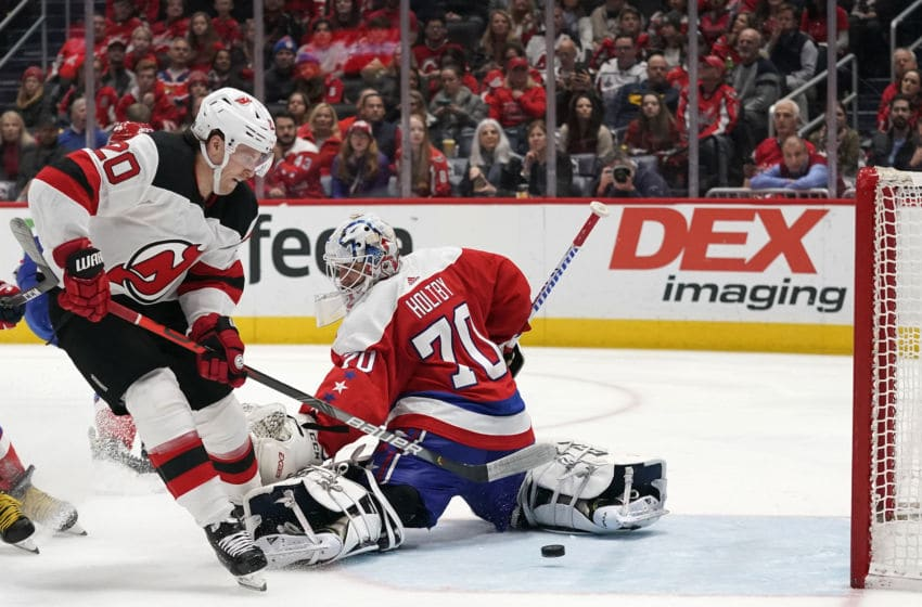 WASHINGTON, DC - JANUARY 11: Blake Coleman #20 of the New Jersey Devils scores a goal against Braden Holtby #70 of the Washington Capitals in the second period at Capital One Arena on January 11, 2020 in Washington, DC. (Photo by Patrick McDermott/NHLI via Getty Images)