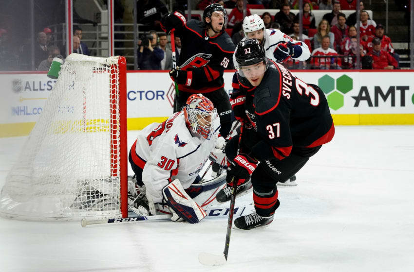 RALEIGH, NC - JANUARY 3: Andrei Svechnikov #37 of the Carolina Hurricanes skates near the crease as Ilya Samsonov #30 of the Washington Capitals protects the net during an NHL game on January 3, 2020 at PNC Arena in Raleigh, North Carolina. (Photo by Gregg Forwerck/NHLI via Getty Images)