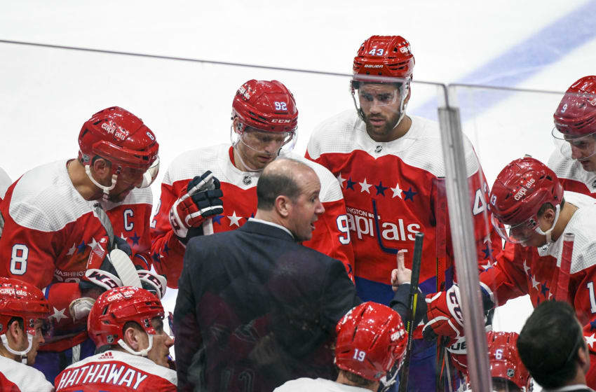 WASHINGTON, DC - FEBRUARY 08: Washington Capitals head coach Todd Reirden has words with (L-R) Washington Capitals left wing Alex Ovechkin (8), center Evgeny Kuznetsov (92) and right wing Tom Wilson (43) during a time out during the second period in the game against the Philadelphia Flyers on February 8, 2020 at the Capital One Arena in Washington, D.C. (Photo by Mark Goldman/Icon Sportswire via Getty Images)