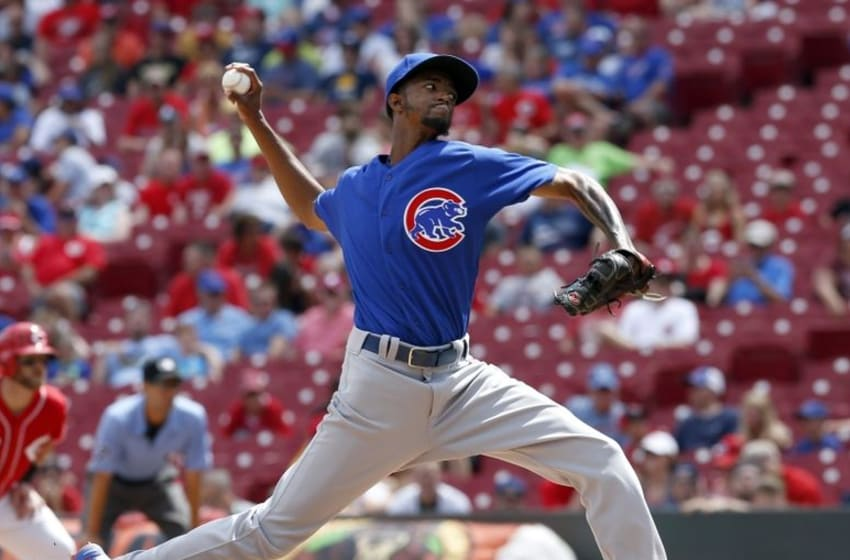 Jun 29, 2016; Cincinnati, OH, USA; Chicago Cubs relief pitcher Carl Edwards Jr. throws against the Cincinnati Reds during the ninth inning at Great American Ball Park. The Cubs won 9-2. Mandatory Credit: David Kohl-USA TODAY Sports