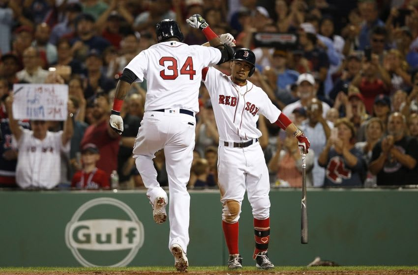 Aug 28, 2016; Boston, MA, USA; Boston Red Sox right fielder Mookie Betts (50) congratulates designated hitter David Ortiz (34) on hitting a solo home run during the fourth inning against the Kansas City Royals at Fenway Park. Mandatory Credit: Greg M. Cooper-USA TODAY Sports