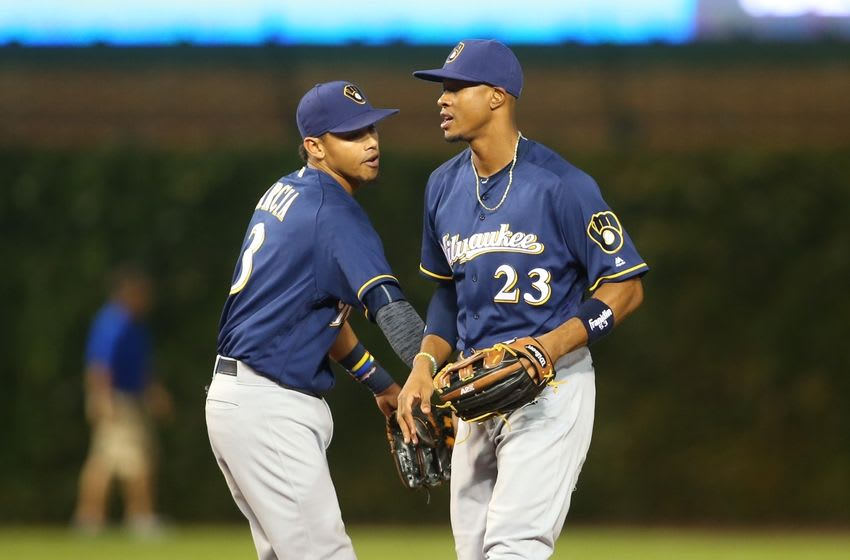 Sep 15, 2016; Chicago, IL, USA; Milwaukee Brewers shortstop Orlando Arcia (3) and center fielder Keon Broxton (23) celebrate after defeating the Chicago Cubs at Wrigley Field. Mandatory Credit: Caylor Arnold-USA TODAY Sports