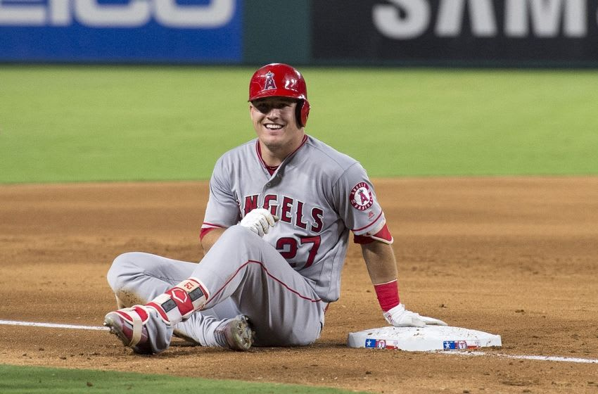 Sep 19, 2016; Arlington, TX, USA; Los Angeles Angels center fielder Mike Trout (27) smiles to the bench after hitting a triple and driving in a run during the sixth inning against the Texas Rangers at Globe Life Park in Arlington. Mandatory Credit: Jerome Miron-USA TODAY Sports