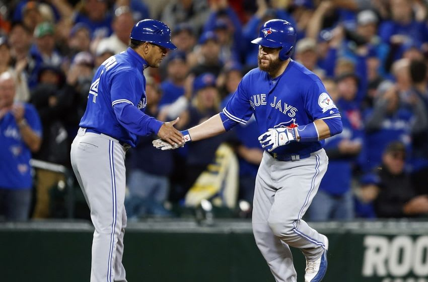 Sep 20, 2016; Seattle, WA, USA; Toronto Blue Jays catcher Russell Martin (55) is greeted by Toronto Blue Jays third base coach Luis Rivera (4) as he runs the bases following his fourth inning two-run homer against the Seattle Mariners at Safeco Field. Toronto defeated Seattle, 10-2. Mandatory Credit: Joe Nicholson-USA TODAY Sports