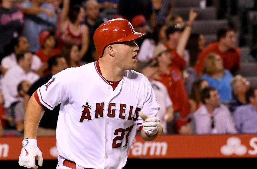 Sep 26, 2016; Anaheim, CA, USA; Los Angeles Angels fans cheer as center fielder Mike Trout (27) watches the ball leave the park on a solo home run in the fourth of the game against the Oakland Athletics at Angel Stadium of Anaheim. Mandatory Credit: Jayne Kamin-Oncea-USA TODAY Sports