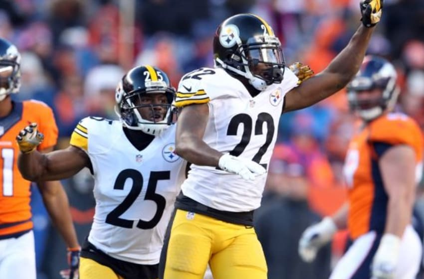 Jan 17, 2016; Denver, CO, USA; Pittsburgh Steelers cornerback William Gay (22) and defensive back Brandon Boykin (25) celebrate after a defensive stop against the Denver Broncos during the third quarter of the AFC Divisional round playoff game at Sports Authority Field at Mile High. Mandatory Credit: Matthew Emmons-USA TODAY Sports