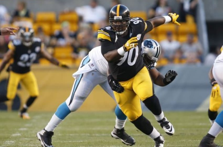 Aug 28, 2014; Pittsburgh, PA, USA; Pittsburgh Steelers nose tackle Steve McLendon (90) rushes the line of scrimmage against the Carolina Panthers during the first quarter at Heinz Field. The Panthers won 10-0. Mandatory Credit: Charles LeClaire-USA TODAY Sports