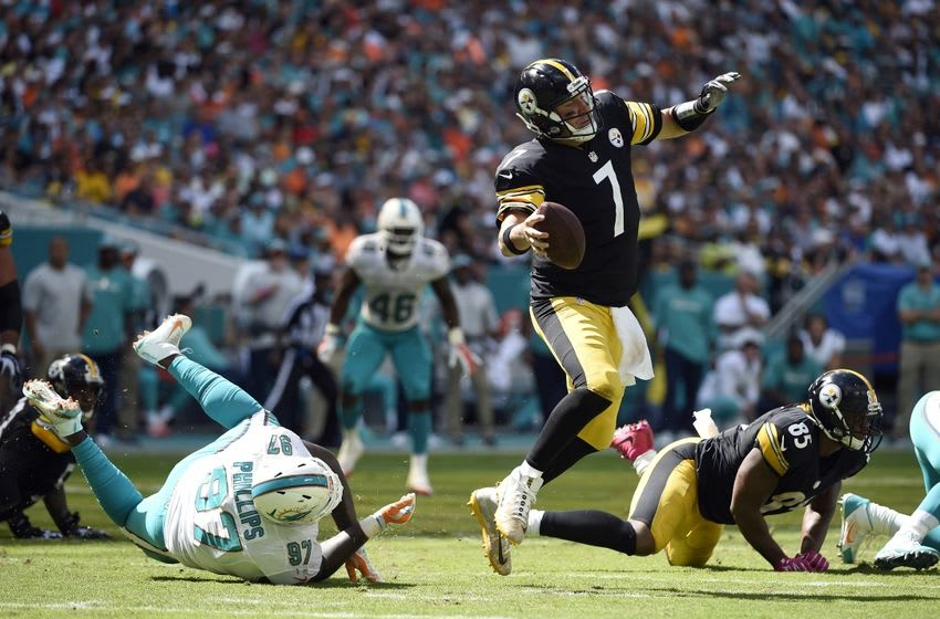 Oct 16, 2016; Miami Gardens, FL, USA; Pittsburgh Steelers quarterback Ben Roethlisberger (7) is tripped by by Miami Dolphins defensive tackle Jordan Phillips (97) during the first half at Hard Rock Stadium. Mandatory Credit: Steve Mitchell-USA TODAY Sports