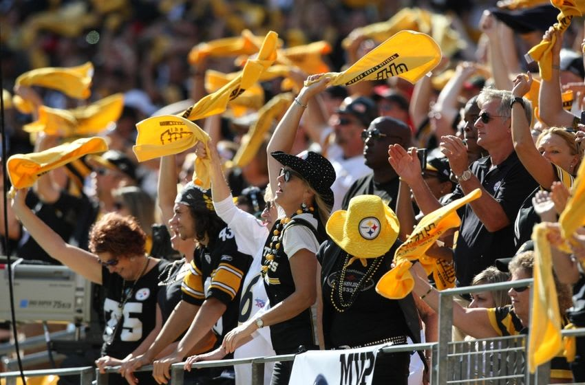 Sep 20, 2015; Pittsburgh, PA, USA; Pittsburgh Steelers fans wave Terrible Towels during a break in action during the second half against the San Francisco 49ers at Heinz Field. The Steelers won the game, 43-18. Mandatory Credit: Jason Bridge-USA TODAY Sports