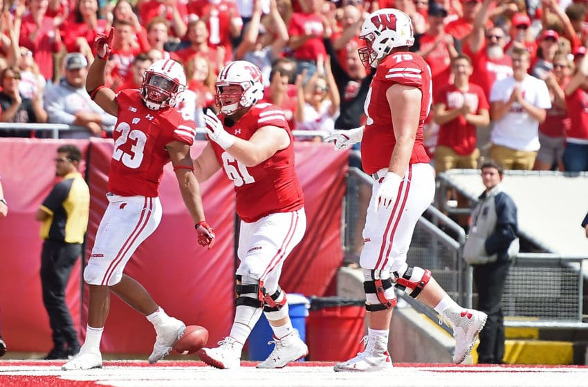 MADISON, WI - SEPTEMBER 08: Jonathan Taylor #23 of the Wisconsin Badgers celebrates a touchdown with Tyler Biadasz #61 during the second half against the New Mexico Lobos at Camp Randall Stadium on September 8, 2018 in Madison, Wisconsin. (Photo by Stacy Revere/Getty Images)