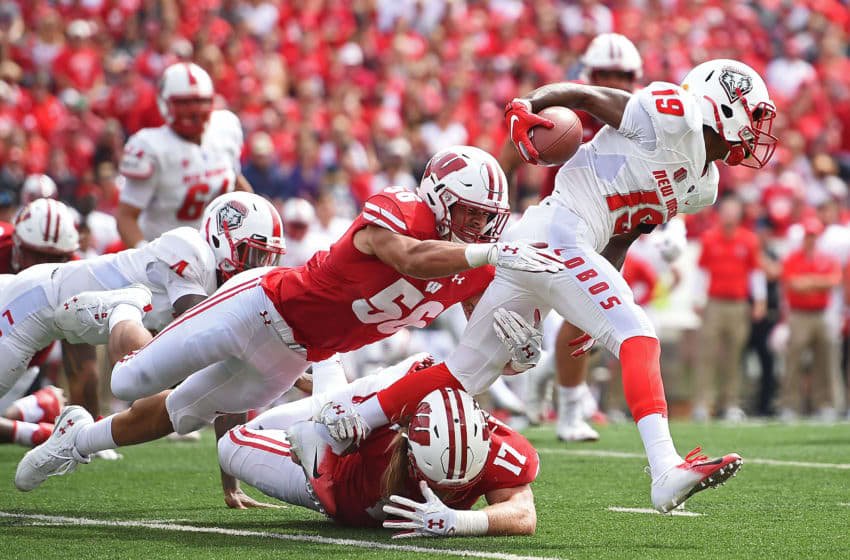 MADISON, WI - SEPTEMBER 08: Elijah Lilly #19 of the New Mexico Lobos is brought down by Andrew Van Ginkel #17 and Zack Baun #56 of the Wisconsin Badgers during a game at Camp Randall Stadium on September 8, 2018 in Madison, Wisconsin. (Photo by Stacy Revere/Getty Images)