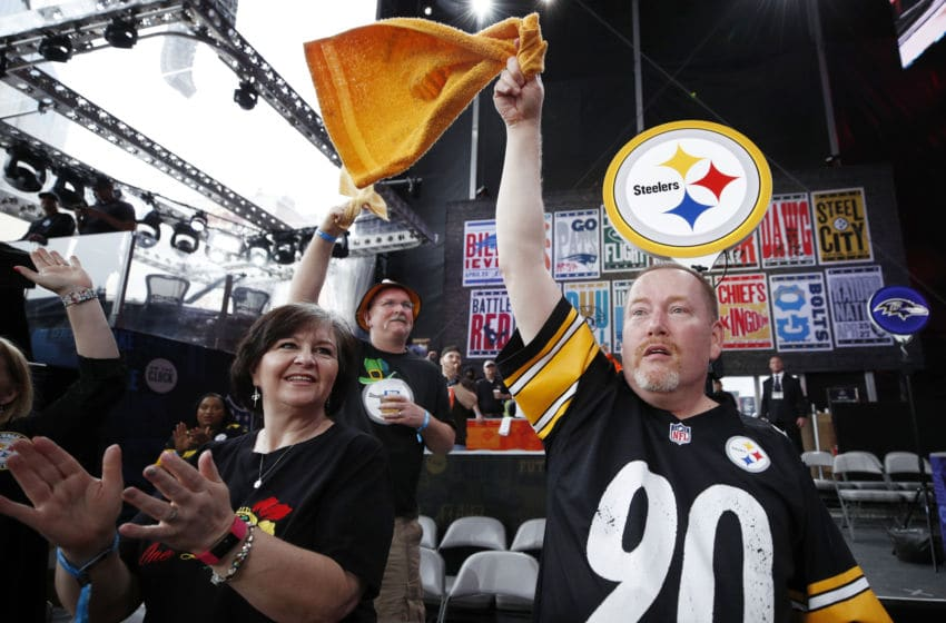 NASHVILLE, TN - APRIL 25: A pair of Pittsburgh Steelers fans are seen prior to the first round of the NFL Draft on April 25, 2019 in Nashville, Tennessee. (Photo by Joe Robbins/Getty Images)