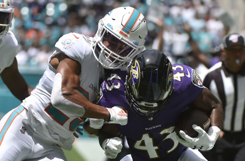 MIAMI, FL - SEPTEMBER 08: Minkah Fitzpatrick #29 of the Miami Dolphins knocks Justice Hill #43 of the Baltimore Ravens out of bounds during the first quarter of the game at Hard Rock Stadium on September 8, 2019 in Miami, Florida. (Photo by Eric Espada/Getty Images)