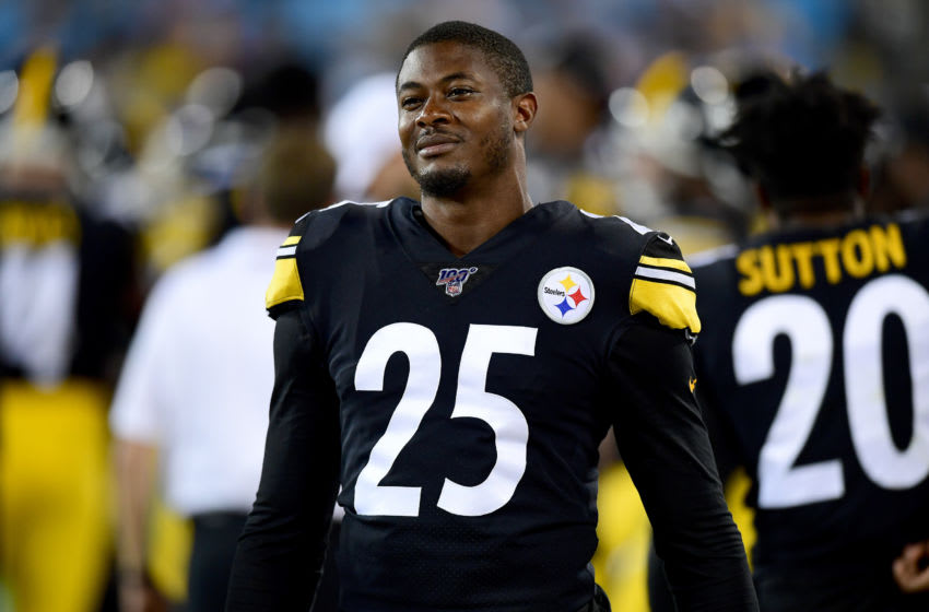 CHARLOTTE, NORTH CAROLINA - AUGUST 29: Artie Burns #25 of the Pittsburgh Steelers watches from the sidelines during their preseason game against the Carolina Panthers at Bank of America Stadium on August 29, 2019 in Charlotte, North Carolina. (Photo by Jacob Kupferman/Getty Images)