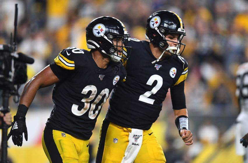 PITTSBURGH, PA - SEPTEMBER 30: James Conner #30 of the Pittsburgh Steelers celebrates his touchdown with Mason Rudolph #2 during the second quarter against the Cincinnati Bengals at Heinz Field on September 30, 2019 in Pittsburgh, Pennsylvania. (Photo by Joe Sargent/Getty Images)