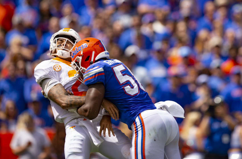 GAINESVILLE, FL- SEPTEMBER 21: Jarrett Guarantano #2 of the Tennessee Volunteers is sacked by Jonathan Greenard #58 of the Florida Gators at Ben Hill Griffin Stadium on September 21, 2019 in Gainesville, Florida. (Photo by Carmen Mandato/Getty Images)