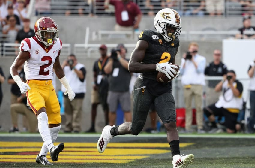 TEMPE, ARIZONA - NOVEMBER 09: Wide receiver Brandon Aiyuk #2 of the Arizona State Sun Devils scores on a two yard touchdown reception ahead of cornerback Olaijah Griffin #2 of the USC Trojans during the second half of the NCAAF game at Sun Devil Stadium on November 09, 2019 in Tempe, Arizona. The Trojans defeated the Sun Devils 31-26. (Photo by Christian Petersen/Getty Images)