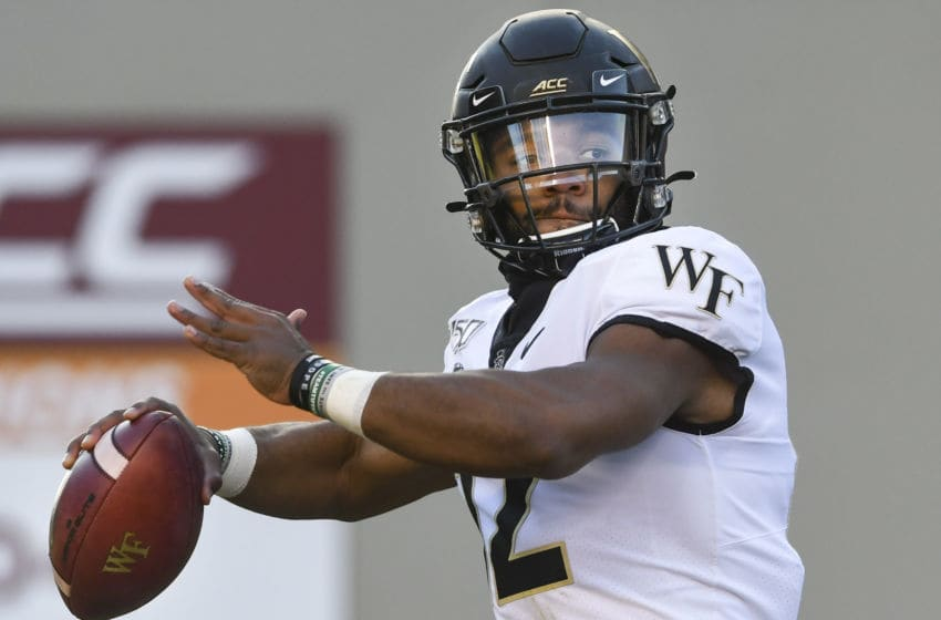 BLACKSBURG, VA - NOVEMBER 09: Quarterback Jamie Newman #12 of the Wake Forest Demon Deacons looks to pass against the Virginia Tech Hokies in the first half at Lane Stadium on November 9, 2019 in Blacksburg, Virginia. (Photo by Michael Shroyer/Getty Images)