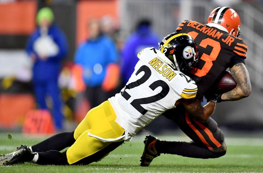 CLEVELAND, OHIO - NOVEMBER 14: Wide receiver Odell Beckham #13 of the Cleveland Browns is tackled by cornerback Steven Nelson #22 of the Pittsburgh Steelers after review falls 1 yard short of the touchdown in the first quarter of the game at FirstEnergy Stadium on November 14, 2019 in Cleveland, Ohio. (Photo by Jamie Sabau/Getty Images)