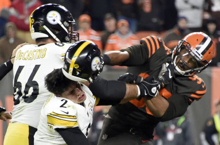 CLEVELAND, OHIO - NOVEMBER 14: Defensive end Myles Garrett #95 of the Cleveland Browns hits Quarterback Mason Rudolph #2 of the Pittsburgh Steelers over the head with his helmet during the second half in the game at FirstEnergy Stadium on November 14, 2019 in Cleveland, Ohio. (Photo by Jason Miller/Getty Images)