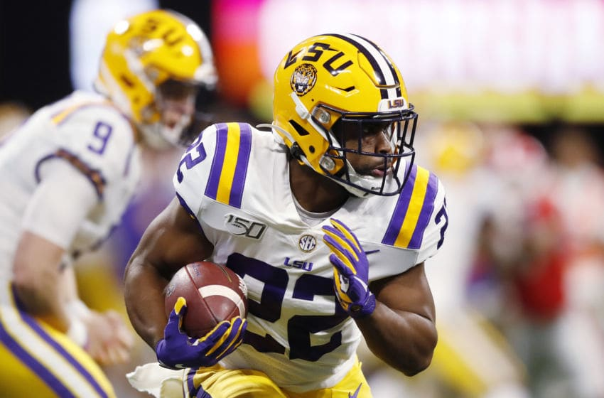 ATLANTA, GEORGIA - DECEMBER 07: Clyde Edwards-Helaire #22 of the LSU Tigers carries the ball in the first half against the Georgia Bulldogs during the SEC Championship game at Mercedes-Benz Stadium on December 07, 2019 in Atlanta, Georgia. (Photo by Todd Kirkland/Getty Images)